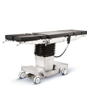 универсальный операционный стол / электрический / с регулируемой высотой / на роликах